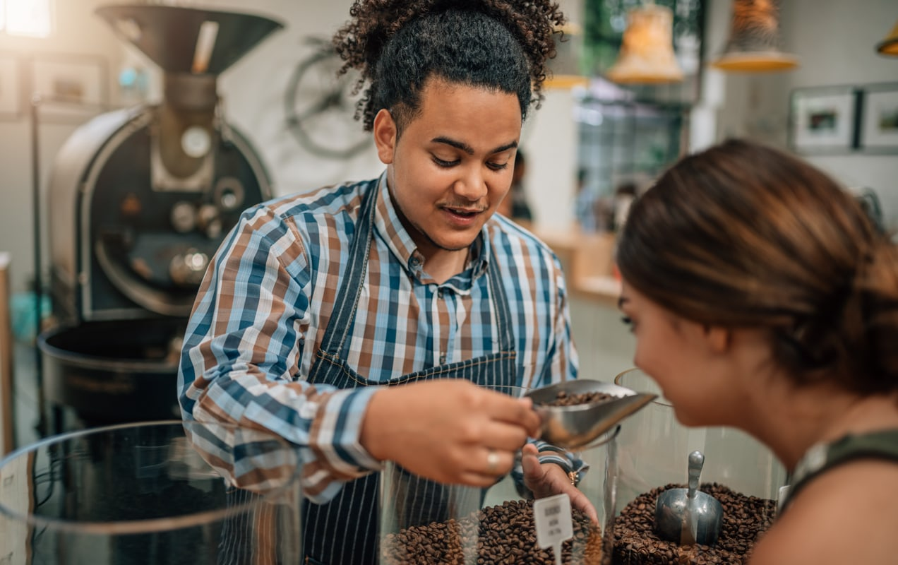 coffee shop owner serving coffee to a customer