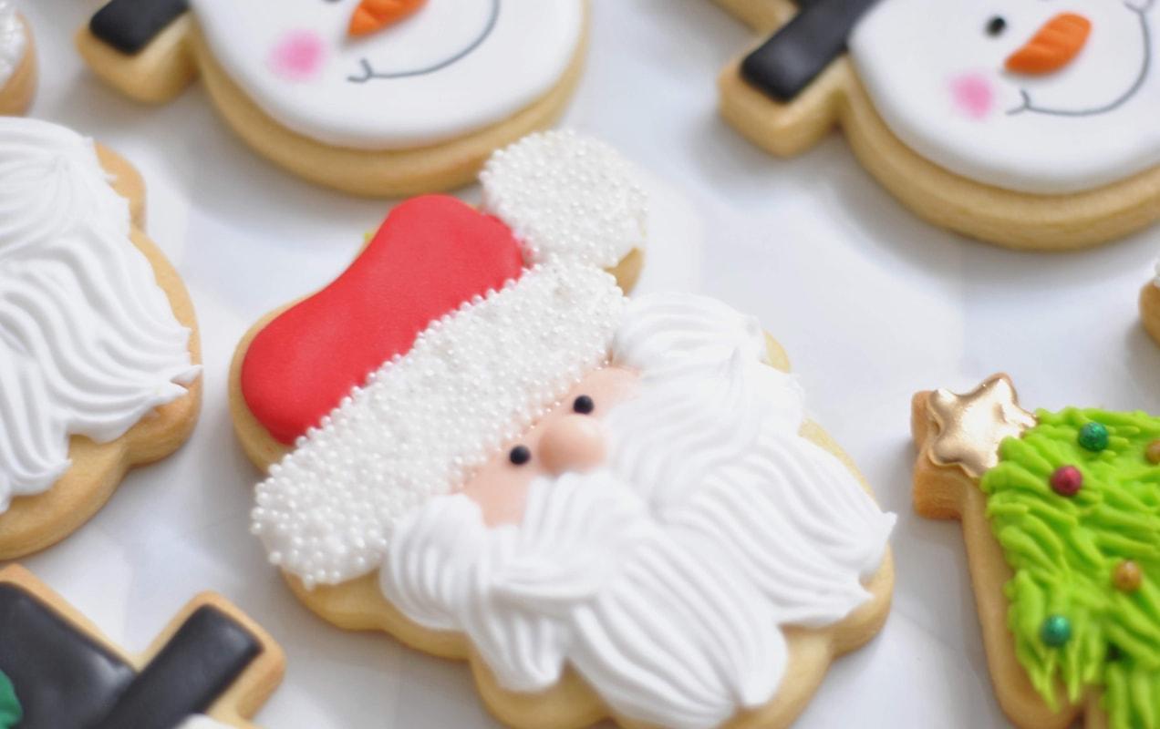 box of iced Christmas cookies